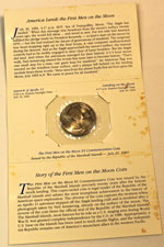 Marshall Islands First Men on the Moon $5 coin holder opened showing contents