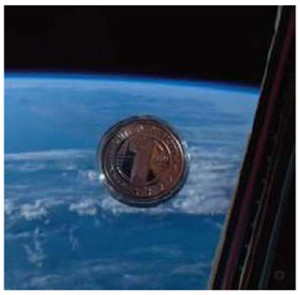 United Future World Coin reverse image in the International Space Station