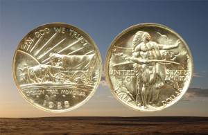 Oregon Trail Commemorative Silver Half Dollar and a prairie sunset