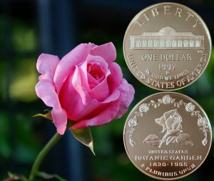 Botanic Garden Commemorative Silver Dollar Coin beside a rose