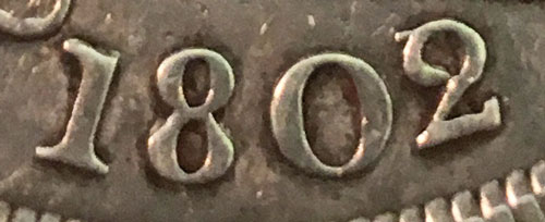 Close-up of 1802 over 1 Silver Dollar Date