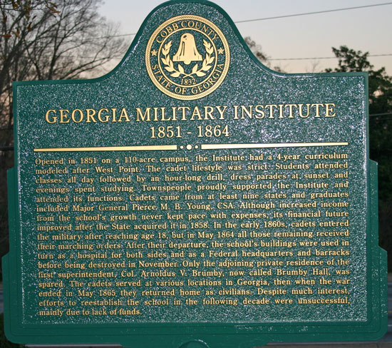 Georgia Military Institute Historical Marker on the property in front of the coin shows hotel