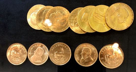 several gold 20 coronas and 1 ounce Kruggerands