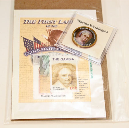 "First Lady stamps and stickered ""coin"""