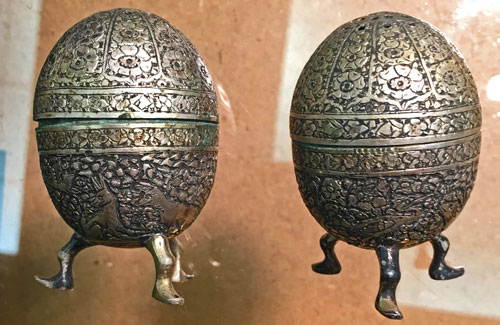 Vintage silver salt and pepper shakers with intricate design