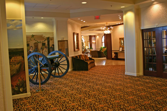 cannon and mural between the coin shows in the conference center and the hotel's main lobby